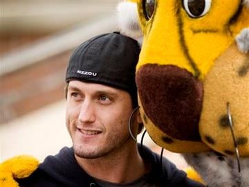 World Series MVP David Freese, of the St. Louis Cardinals, poses with the Missouri mascot during the second quarter of the Texas-Missouri NCAA college football game Saturday, Nov. 12, 2011, in Columbia, Mo. (AP Photo/L.G. Patterson) By L.G. Patterson