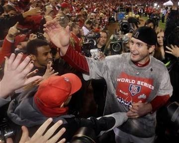 St. Louis Cardinals' David Freese celebrates after Game 7 of baseball's World Series against the Texas Rangers Friday, Oct. 28, 2011, in St. Louis. The Cardinals won 6-2 to win the series. (AP Photo/Matt Slocum) By Matt Slocum