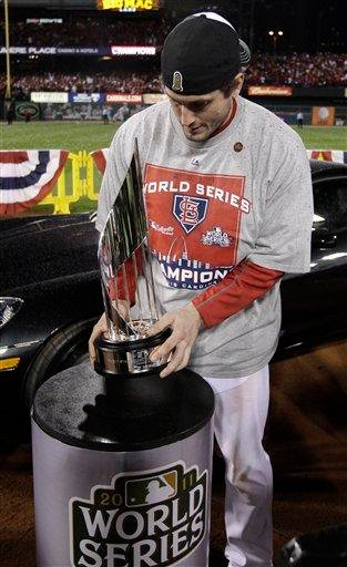 St. Louis Cardinals' David Freese holds up the MVP trophy after  Game 7 of baseball's World Series against the Texas Rangers Friday, Oct. 28, 2011, in St. Louis. The Cardinals won 6-2 to win the series.  (AP Photo/Charlie Riedel) By Charlie Riedel