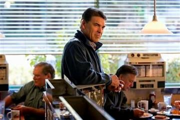 Republican presidential candidate, Texas Gov. Rick Perry waits to be introduced at a campaign stop at the Hilton Head Diner, Friday, Jan. 13, 2012, in Hilton Head, S.C. (AP Photo/David Goldman) By David Goldman