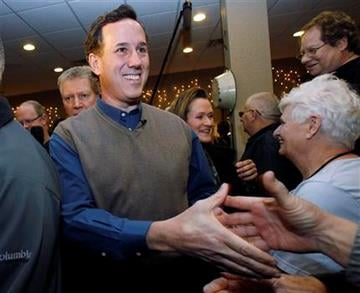 Republican presidential candidate former Pennsylvania Sen. Rick Santorum shakes hands during a meet and greet campaign stop at Pizza Ranch, Monday, Jan. 2, 2012, in Altoona, Iowa. (AP Photo/Eric Gay) By Eric Gay