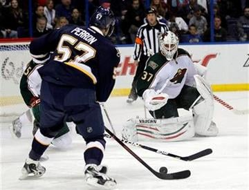 St. Louis Blues' David Perron, left, shoots and scores past Minnesota Wild goalie Josh Harding during the second period of an NHL hockey game Saturday, Jan. 14, 2012, in St. Louis. (AP Photo/Jeff Roberson) By Jeff Roberson
