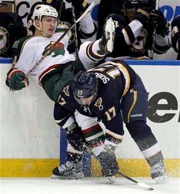 Minnesota Wild's Justin Falk, left, and St. Louis Blues' Vladimir Sobotka, of the Czech Republic, collide along the boards during the second period of an NHL hockey game Saturday, Jan. 14, 2012, in St. Louis. (AP Photo/Jeff Roberson) By Jeff Roberson
