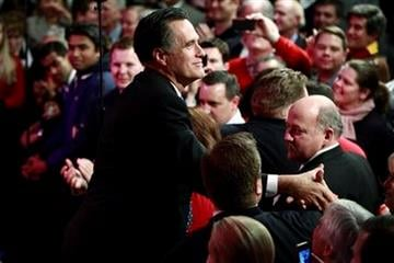 Republican presidential candidate, former Massachusetts Gov. Mitt Romney, celebrates his New Hampshire Primary Election win in Manchester, N.H., Tuesday, Jan. 10, 2012. (AP Photo/Charles Dharapak) By Charles Dharapak
