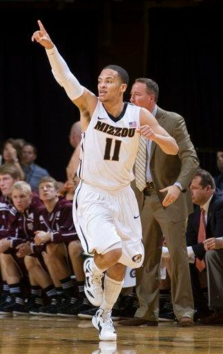 Missouri's Michael Dixon celebrates after making a 3-point shot during the first half of an NCAA college basketball game against Texas A&M on Monday, Jan. 16, 2012, in Columbia, Mo. (AP Photo/L.G. Patterson) By L.G. Patterson
