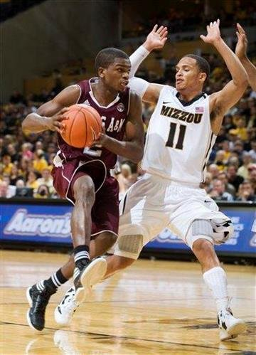 Texas A&M's Naji Hibbert, left, dribbles past Missouri's Michael Dixon during the first half of an NCAA college basketball game Monday, Jan. 16, 2012, in Columbia, Mo. (AP Photo/L.G. Patterson) By L.G. PATTERSON