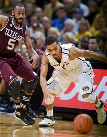 Missouri's Phil Pressey, right, and Texas A&M's Dash Harris, left, scramble for a loose ball during the first half of an NCAA college basketball game Monday, Jan. 16, 2012, in Columbia, Mo.  (AP Photo/L.G. Patterson) By L.G. Patterson