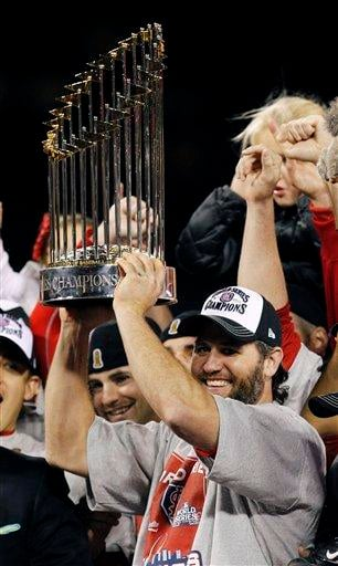 St. Louis Cardinals' Lance Berkman holds up the Commissioner's Trophy after Game 7 of baseball's World Series against the Texas Rangers Friday, Oct. 28, 2011, in St. Louis. The Cardinals won 6-2 to win the series. (AP Photo/Eric Gay) By Eric Gay