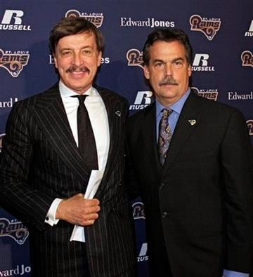 Jeff Fisher, right,  poses with team owner Stan Kroenke at a news conference where Fisher was officially introduced as the new head football coach of the St. Louis Rams NFL team, in St. Louis, Tuesday, Jan. 16, 2012. (AP Photo/Tom Gannam) By Tom Gannam