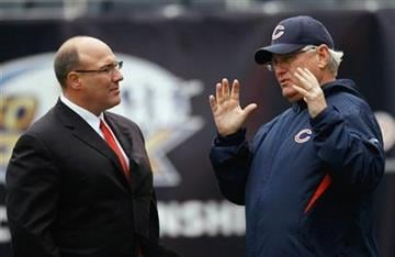 Chicago Bears offensive coordinator Mike Martz, right, talks with Kansas City Chiefs general manager Scott Pioli before an NFL football game in Chicago, Sunday, Dec. 4, 2011. (AP Photo/Charles Rex Arbogast) By Charles Rex Arbogast