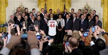 President Barack Obama and first lady Michelle Obama pose for a photo with the 2011 World Series baseball Champion St. Louis Cardinals, Tuesday, Jan. 17, 2012, in the East Room of the White House in Washington. (AP Photo/Susan Walsh) By Susan Walsh
