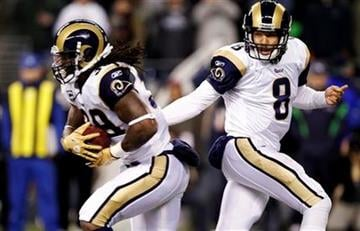 St. Louis Rams quarterback Sam Bradford (8) hands off to running back Steven Jackson in the first half of an NFL football game against the Seattle Seahawks, Monday, Dec. 12, 2011, in Seattle. (AP Photo/Elaine Thompson) By Elaine Thompson