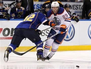 St. Louis Blues' David Backes, left, and Edmonton Oilers' Sam Gagner (89) collide as they chase a loose puck during the first period of an NHL hockey game Thursday, Jan. 19, 2012, in St. Louis. (AP Photo/Jeff Roberson) By Jeff Roberson