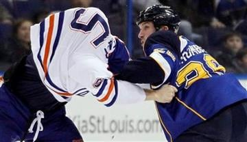 Edmonton Oilers' Ben Eager, left, and St. Louis Blues' B.J. Crombeen fight during the first period of an NHL hockey game Thursday, Jan. 19, 2012, in St. Louis. (AP Photo/Jeff Roberson) By Jeff Roberson