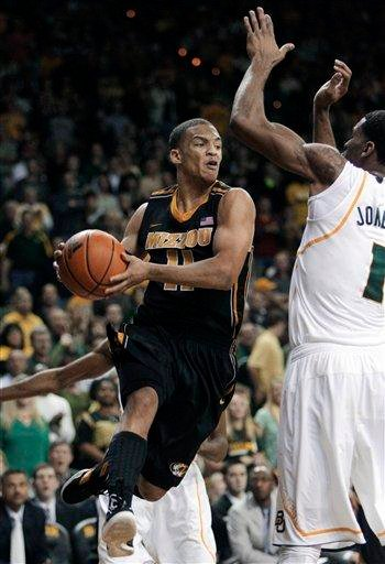 Missouri guard Michael Dixon (11) drives to the basket against Baylor forward Perry Jones III (1) in the first half of an NCAA college basketball game on Saturday, Jan. 21, 2012, in Waco, Texas. (AP Photo/Tony Gutierrez) By Tony Gutierrez