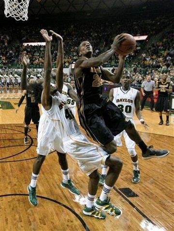 Missouri guard Kim English (24) gets by Baylor forward Anthony Jones, left, for a shot in the first half of an NCAA college basketball game, Saturday, Jan. 21, 2012, in Waco, Texas. (AP Photo/Tony Gutierrez) By Tony Gutierrez