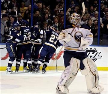 St. Louis Blues' David Perron (57) celebrates with teammates after scoring a goal as Buffalo Sabres goalie Ryan Miller (30) looks away in the second period of an NHL hockey game, Saturday, Jan. 21, 2012, in St. Louis. (AP Photo/Tom Gannam) By Tom Gannam