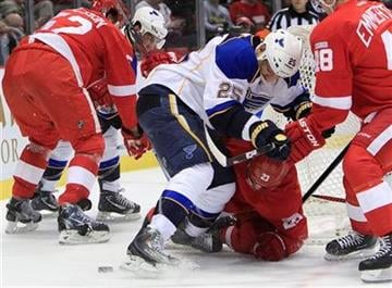 St. Louis Blues right wing Chris Stewart (25) and Detroit Red Wings defenseman Brad Stuart (23) vie for the puck during the first period of an NHL hockey game in Detroit, Monday, Jan. 23, 2012. (AP Photo/Carlos Osorio) By Carlos Osorio