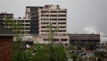 Damage to St. John's Regional Medical Center in Joplin, Mo. is shown after it was hit by a tornado on Sunday, May 22, 2011. (AP Photo/The Wichita Eagle, Jaime Green) By Jaime Green