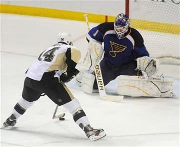Pittsburgh Penguins' Chirs Kunitz (14) sets to score the game winning goal in a shoot out against St. Louis Blues' goalie Brian Elliot (1) in an NHL hockey game Tuesday, Jan. 24, 2012, in St. Louis. (AP Photo/Bill Boyce) By Bill Boyce
