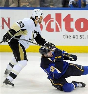 Pittsburgh Penquins' Steve MacIntyre (33) is called for tripping on St. Louis Blues' David Backes in the second period of an NHL hockey game Tuesday, Jan. 24, 2012, in St. Louis. (AP Photo/Bill Boyce) By Bill Boyce