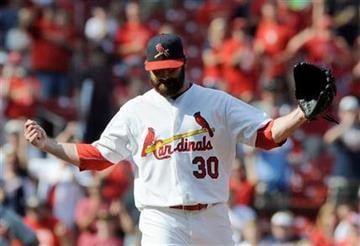 St. Louis Cardinals' Jason Mott celebrates his save in the Cardinals' 6-3  win over the Atlanta Braves in a baseball game Sunday, Sept. 11, 2011, in St. Louis. (AP Photo/Bill Boyce) By Bill Boyce