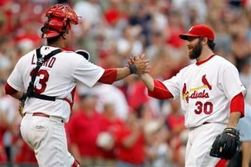 St. Louis Cardinals relief pitcher Jason Motte, right, and teammate Gerald Laird celebrate after the Cardinals' 6-4 victory over the Cincinnati Reds in a baseball game, Saturday, Sept. 3, 2011, in St. Louis. (AP Photo/Jeff Roberson) By Jeff Roberson