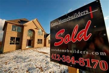 A sold sign is seen in fron of a new home in Jefferson, Pa., Wednesday, Jan. 18, 2012.   The economy likely grew at annual rate of 3 percent in the October-December quarter, according to a survey by FactSet.   (AP Photo/Gene J. Puskar) By Gene J. Puskar