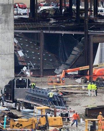 Work continues near a collapse at the Horseshoe Casino under construction, Friday, Jan. 27, 2012, in Cincinnati. Around a dozen workers have been taken to hospitals with minor injuries from the partial collapse. (AP Photo/Al Behrman) By Al Behrman