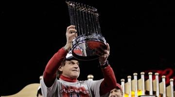 Manager Tony La Russa celebrates with the World Series trophy after defeating the Texas Rangers 6-2 in Game Seven of the MLB World Series at Busch Stadium on October 28, 2011 in St Louis, Missouri.  (Photo by Charlie Riedle-Pool/Getty Images) By Pool