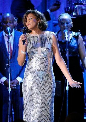 FILE - In this Feb. 13, 2011 file photo, singer Whitney Houston performs at the pre-Grammy gala & salute to industry icons with Clive Davis honoring David Geffen in Beverly Hills, Calif. (AP Photo/Mark J. Terrill, file) By Mark J. Terrill