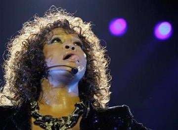 U.S singer Whitney Houston performs at the O2 arena in London as part of her European tour, Sunday, April 25, 2010. (AP Photo/Joel Ryan) By Joel Ryan
