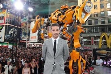 """In this photo provided by StarPix, Shia LaBeouf poses for photographs at the premiere of """"Transformers: Dark of the Moon"""" Tuesday, June 28, 2011, in New York's Times Square. (AP Photo/StarPix, Dave Allocca) By Dave Allocca"""
