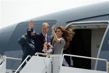 Prince William and Kate, the Duke and Duchess of Cambridge, board their plane as they leave Ottawa on route to Montreal as they continue their Royal Tour of Canada Saturday, July 2, 2011. (AP Photo/Charlie Riedel) By Charlie Riedel