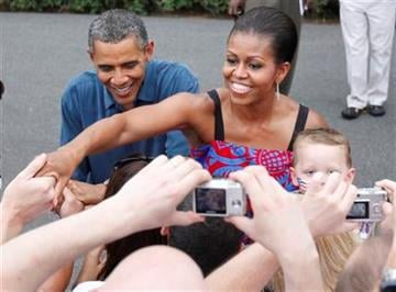 President Barack Obama and first lady Michelle Obama welcome military families to an Independence Day celebration on the South Lawn of the White House in Washington, Monday, July 4, 2011. (AP Photo/Charles Dharapak) By Charles Dharapak