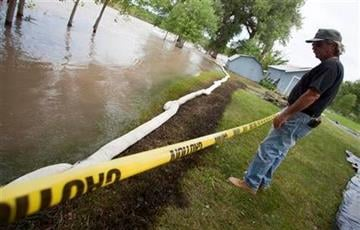 Jim Swanson surveys the oil impact on his property in Laurel, Mont., Tuesday July 4, 2011. An ExxonMobil pipeline near Laurel ruptured and spilled an estimated 1,000 barrels of crude into the Yellowstone. (AP Photo/Jim Urquhart) By Jim Urquhart