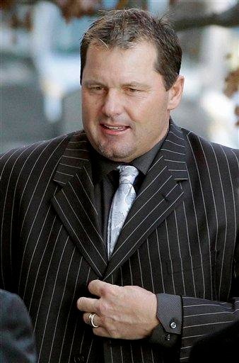 FILE - In this Dec. 8, 2010, file photo, former Major League Baseball pitcher Roger Clemens arrives at court in Washington. (AP Photo/Charles Dharapak, File) By Charles Dharapak