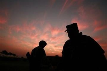 FILE - In this Jan. 25, 2007 file photo, the sun sets at a US military base Camp Liberty in Baghdad, Iraq. By Maya Alleruzzo