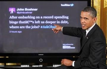 """President Barack Obama answers a tweet from House Speaker John Boehner of Ohio during a """"Twitter Town Hall"""" in the East Room of the White House in Washington, Wednesday, July 6, 2011. (AP Photo/Charles Dharapak) By Charles Dharapak"""