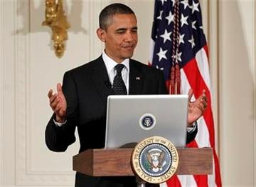 """President Barack Obama tweets during a """"Twitter Town Hall"""" in the East Room of the White House in Washington, Wednesday, July 6, 2011. (AP Photo/Charles Dharapak) By Charles Dharapak"""