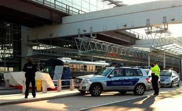 Police surround a bus carrying U.S. soldiers at the site where two US soldiers have been killed in a shooting in front of Terminal 2 of the Frankfurt airport, Germany, Wednesday, March 2, 2011. (AP Photo/dapd, Alexander Becher) By Alexander Becher