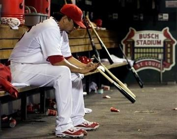 St. Louis Cardinals starting pitcher Kyle Lohse sits in the dugout after giving up a grand slam to Arizona Diamondbacks' Kelly Johnson in the seventh inning of a baseball game, Friday, July 8, 2011 in St. Louis. (AP Photo/Tom Gannam) By Tom Gannam