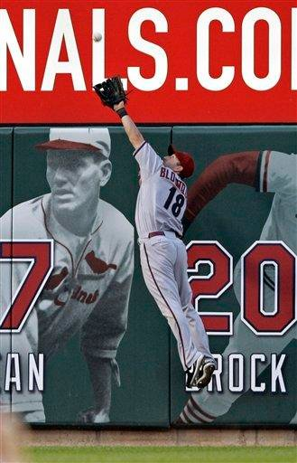 Arizona Diamondbacks left fielder Willie Bloomquist (18) robs St. Louis Cardinals' Lance Berkman of a home run in the fifth inning of a baseball game, Saturday, July 9, 2011 in St. Louis.(AP Photo/Tom Gannam) By Tom Gannam