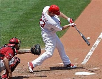 St. Louis Cardinals' David Freese (23) connects for a two-run home run, as Arizona Diamondbacks catcher Henry Blanco watches, in the third inning of a baseball game, Sunday, July 10, 2011 in St. Louis.(AP Photo/Tom Gannam) By Tom Gannam