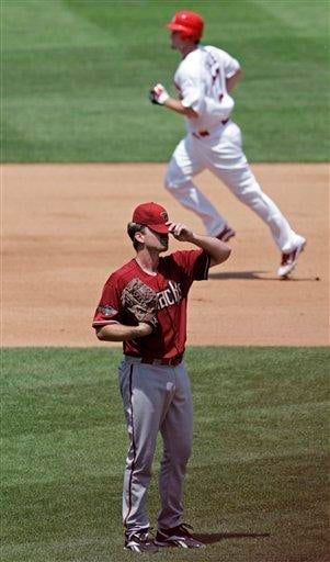 Arizona Diamondbacks starting pitcher Zach Duke regroups as St. Louis Cardinals' David Freese circles the bases after hitting a two-run home run in the third inning of a baseball game, Sunday, July 10, 2011 in St. Louis.(AP Photo/Tom Gannam) By Tom Gannam