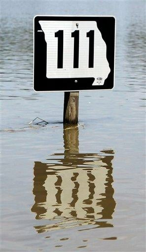 The sign for Missouri Highway 111 leading into Big Lake Village, Mo. shows the depth of the flood water on Wednesday,  July 6, 2011. (Jessica Stewart/St. Joseph News-Press) By Jessica Stewart