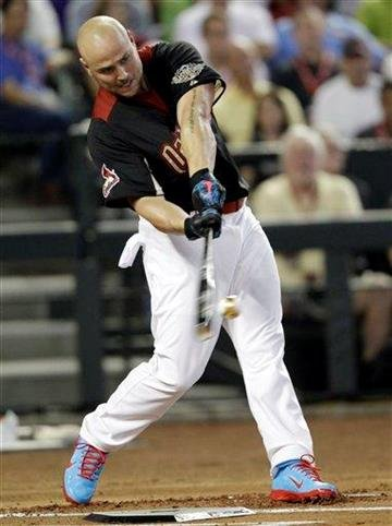 National League's Matt Holliday of the St. Louis Cardinals hits during the MLB Home Run Derby Monday, July 11, 2011, in Phoenix. (AP Photo/David J. Phillip) By David J. Phillip