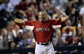 American League's Robinson Cano of the New York Yankees reacts after a home run during the second round of the MLB Home Run Derby Monday, July 11, 2011, in Phoenix. (AP Photo/David J. Phillip) By David J. Phillip