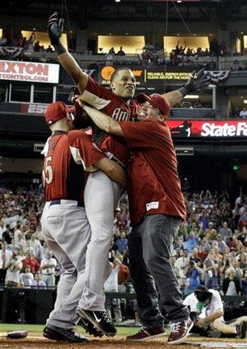 American League's Robinson Cano of the New York Yankees celebrates after winning the MLB Home Run Derby Monday, July 11, 2011, in Phoenix. (AP Photo/David J. Phillip) By David J. Phillip