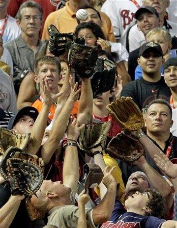 Fans catch a home run by National League's Rickie Weeks of the Milwaukee Brewers during the MLB Home Run Derby Monday, July 11, 2011, in Phoenix. (AP Photo/Matt York) By Matt York